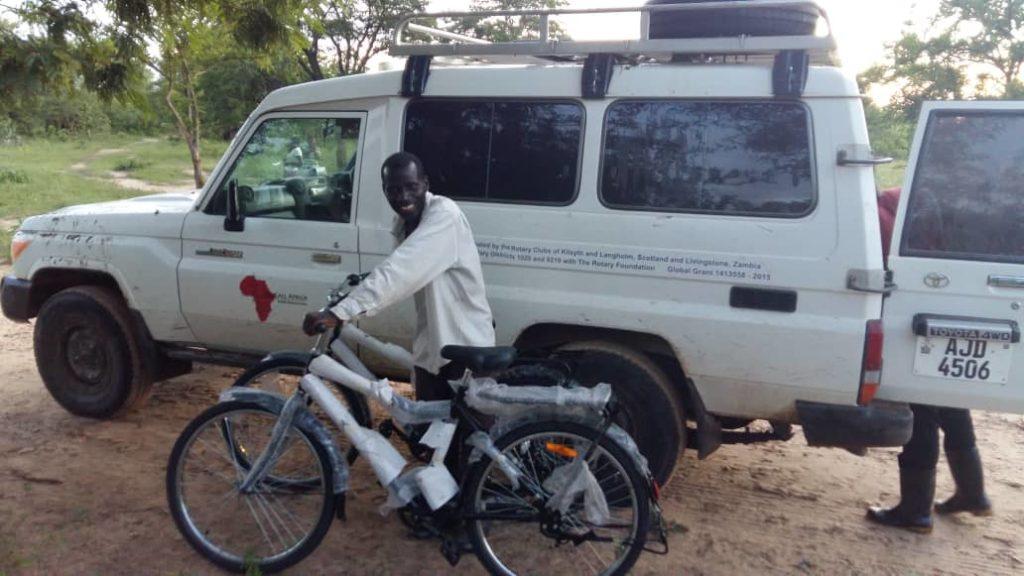 A man pushing two bikes